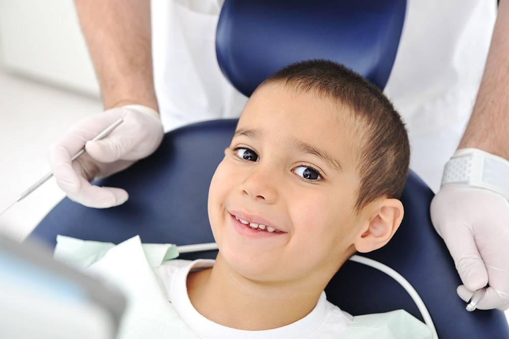 Child Smiling At Dentist