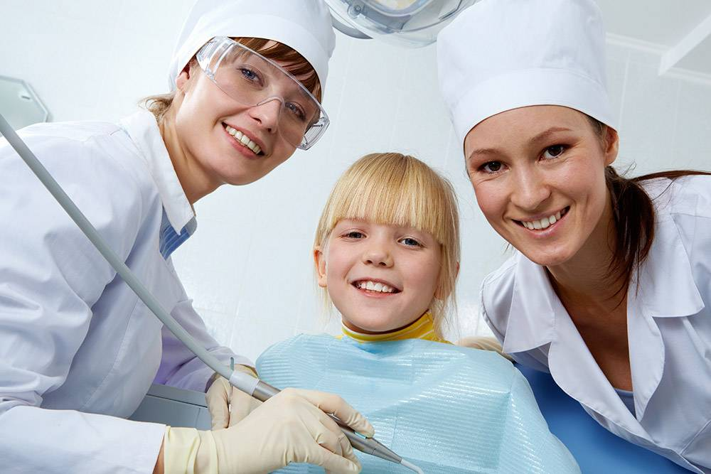 Kid Smiling With Dentist, Hygienist